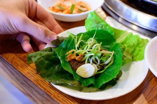Marinated beef wrapped in lettuce and sesame leaf with miso past